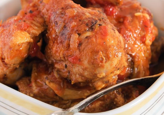 Braised chicken in tomato sauce in a bowl