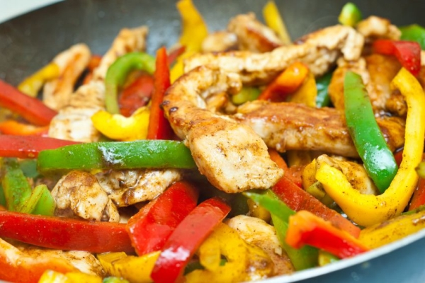 chicken and vegetables stir fried for fajitas